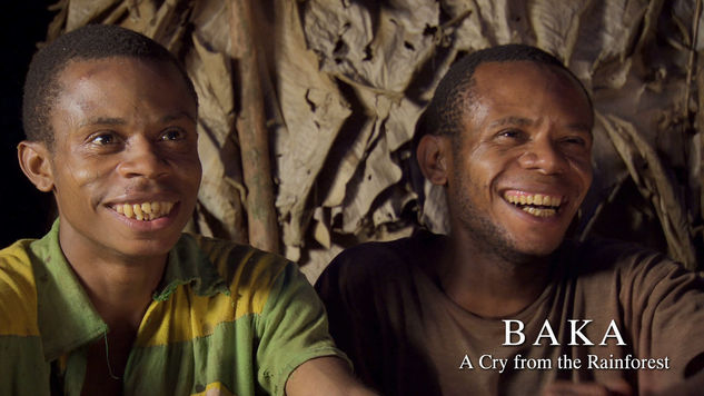 Ali and Yeye laughing at themselves as children in the original Baka film