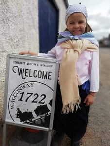 Our youngest re-enactor welcomes visitors to the museum