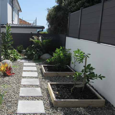 Garden boxes, paving, planting and pebble