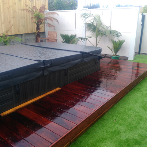 Concrete base pad, timber deck and installation for swim spa