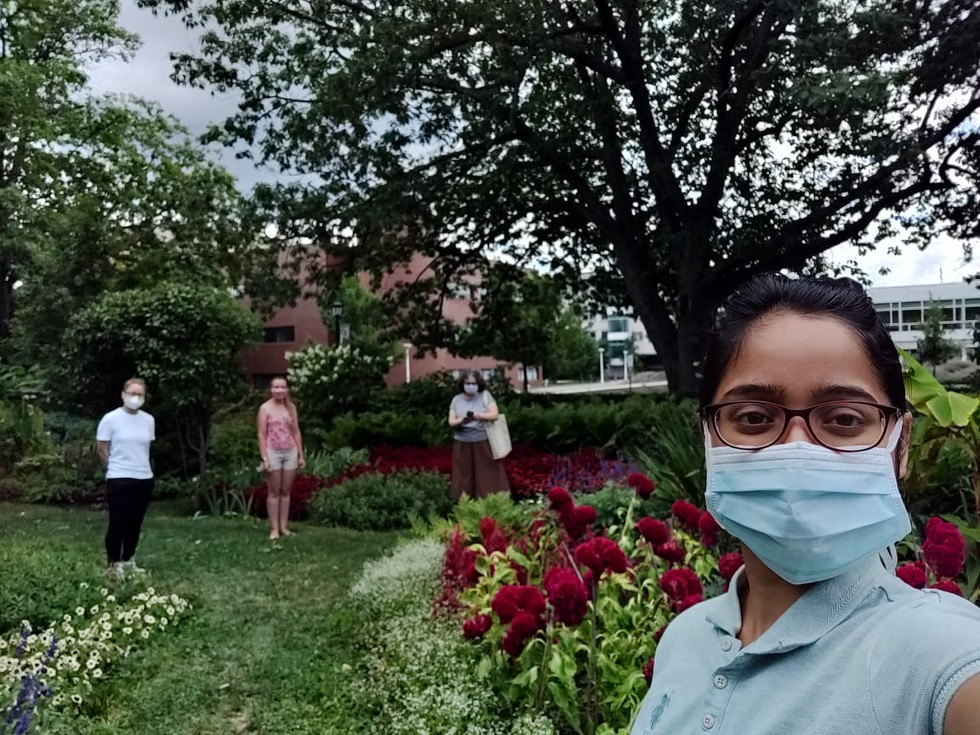 Dr. Wolfner and three lab members go on a socially distant walk to a garden on Cornell campus.
