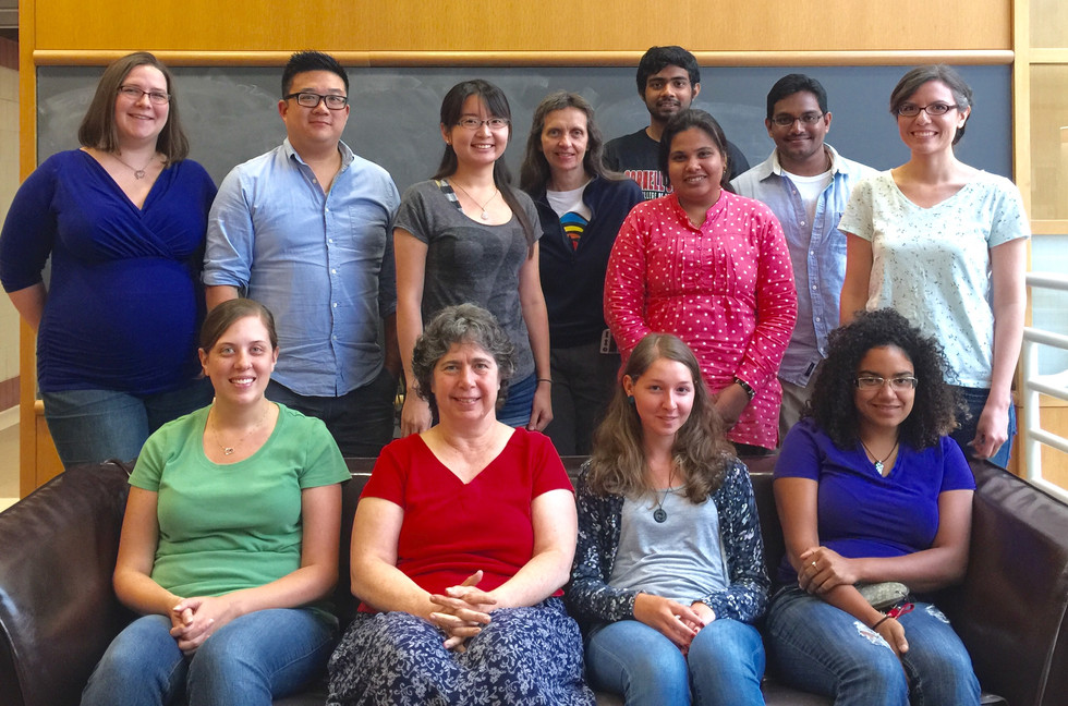 Lab group photo with 12 lab members taken on the fourth floor lounge of the Biotechnology Buidling
