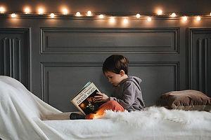 boy-in-gray-jacket-reading-book-3457273