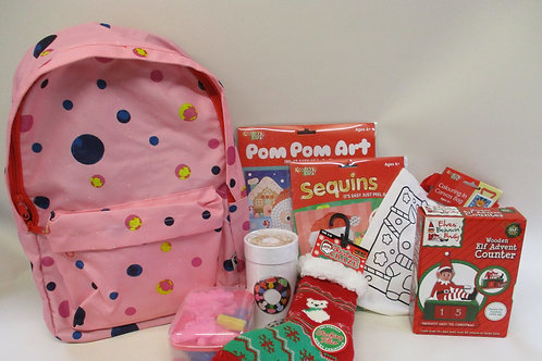 Pink backpack filled with Christmas gifts
