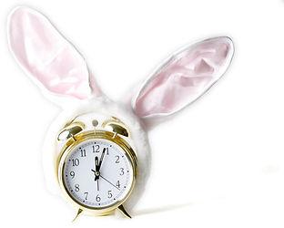 Gold alarm clock with bunny ears on show