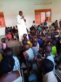 Father celebrating Mass for children