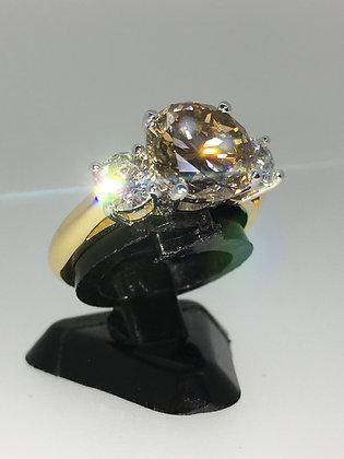 3-Stone Diamond Ring. Center Stone: Cognac, 3.05ct