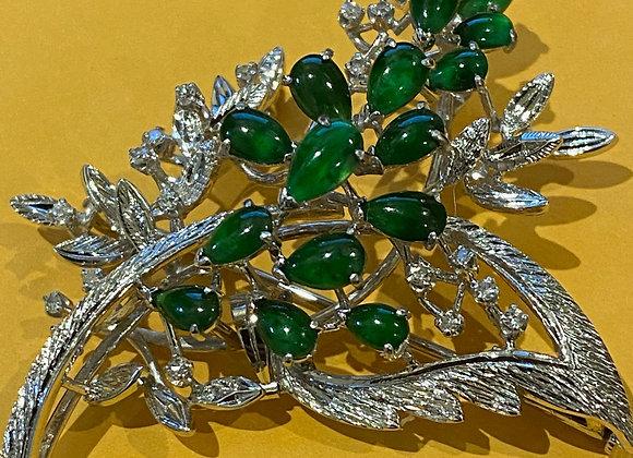 Intense Green Jade & Diamond Brooch in 18K White Gold. Valued at $9,000.