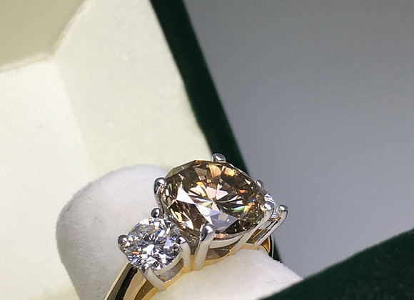 3-Stone Diamond Ring. Center Stone: Cognac, 3.05ct
