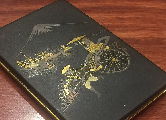 A Damascene Cigarette Case, inlaid with Gold