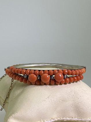 An Antique Coral, Seed Pearl & Silver 800 Bangle