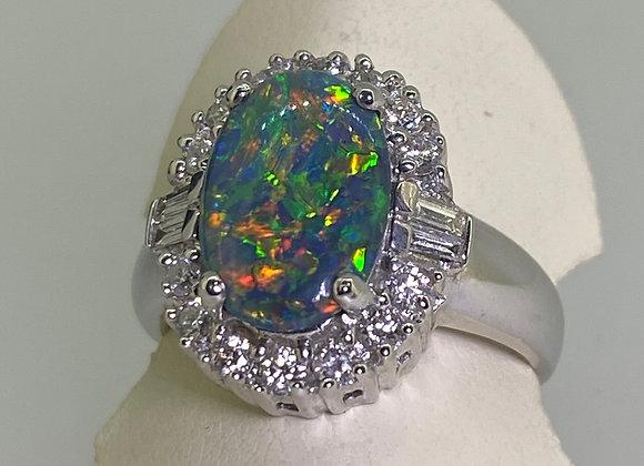 3.00ct Australian Black Opal (12 x 8mm) & 0.56ct Diamond Ring