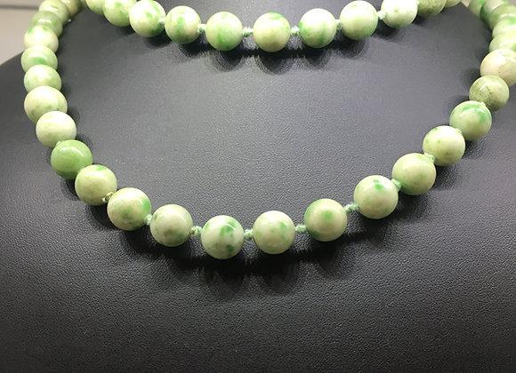 An Opera Length 11mm Jade Bead Necklace