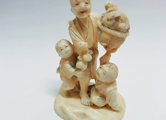 "An Antique Japanese Okimono ""Fisherman and children"" A/F"