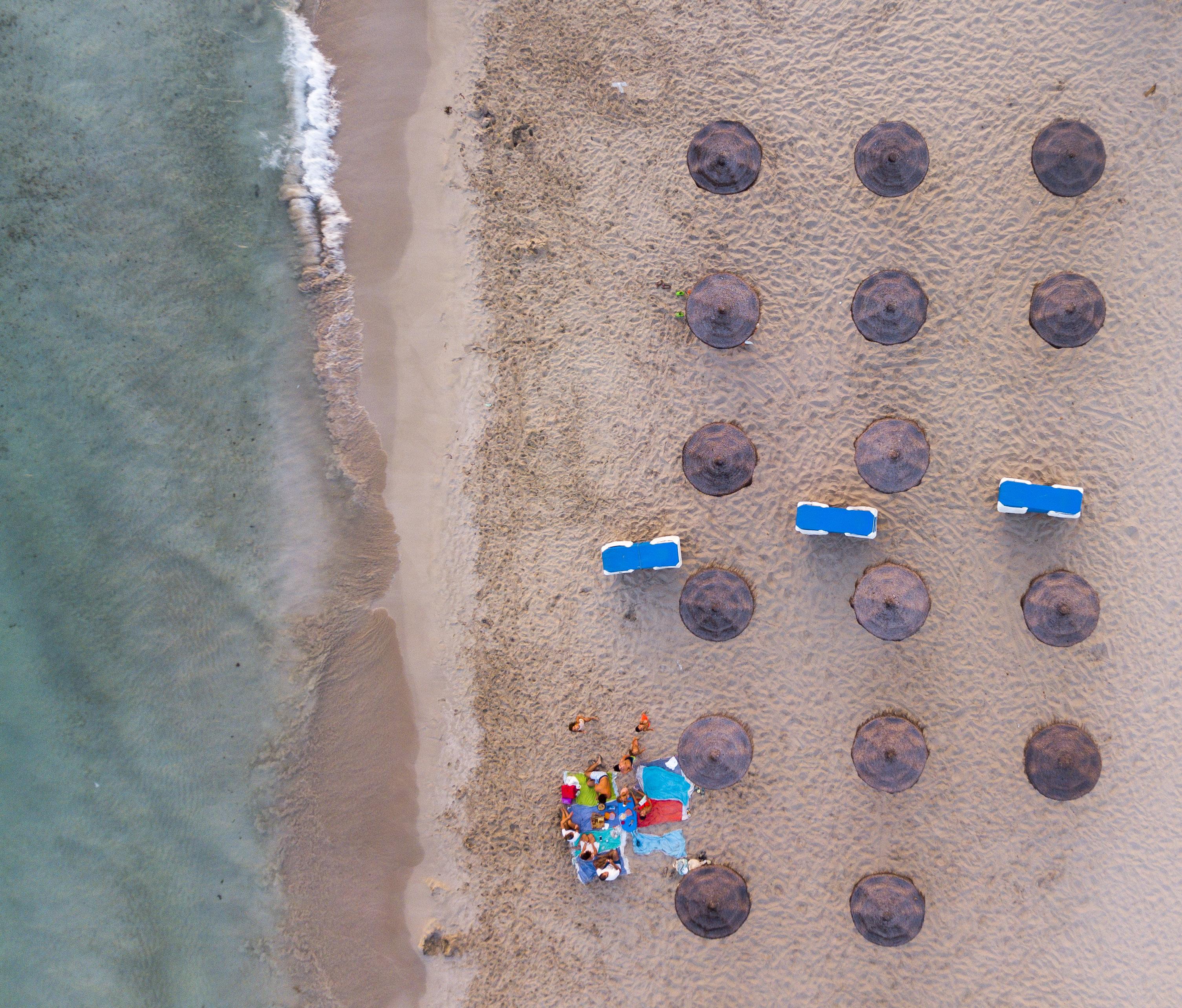 Drone shot of beach Umbrellas