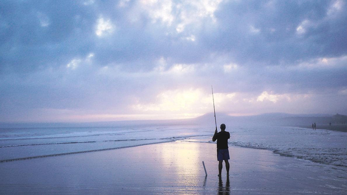 man at sunset fishing
