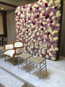 boxwood wall with florals