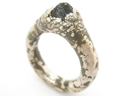 Fine silver, sapphire, enamel.