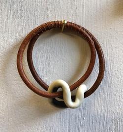 Leather, porcelain, oxide, copper