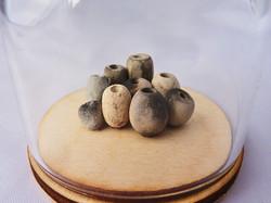Sawdust fired earthenware beads