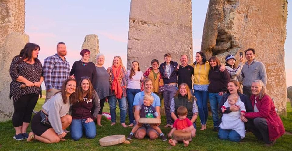 Group of people in front of Stonehenge