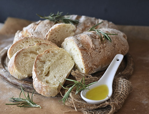 Mixed freshly baked breads, baguettes and panini