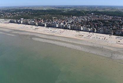 Belgische kust versus Spaanse Costa.jpg