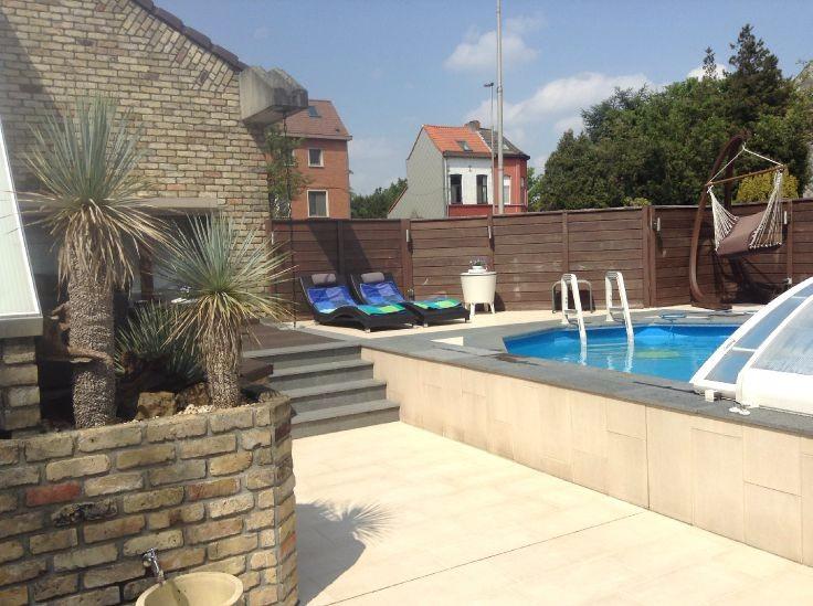 Tuin met verwarmd zwembad