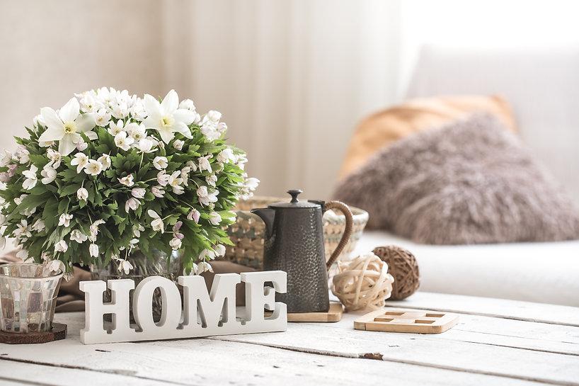 still-life-living-room-with-wooden-inscription-home.jpg