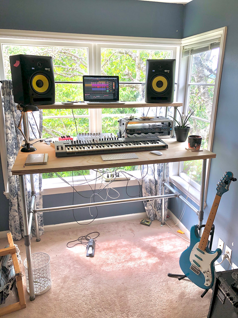 Author's standing desk with computer and music equipment.