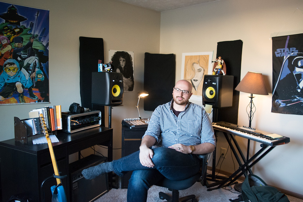Old photo of the author sitting in his workspace surrounded by music equipment.