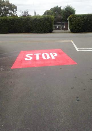 STOP road marking