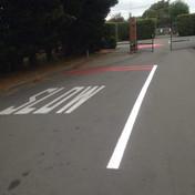 SLOW road marking