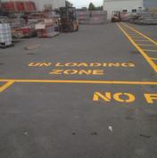 Unloading zone, no parking signage