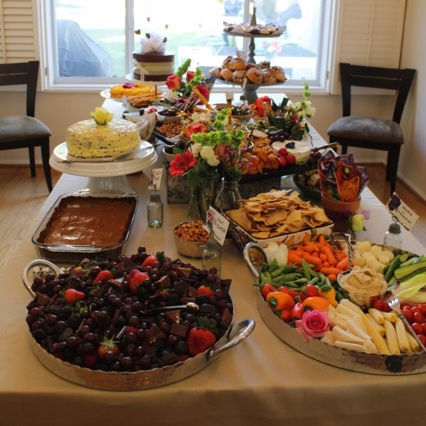 Platters with handles on food buffet table for a 50th tea party