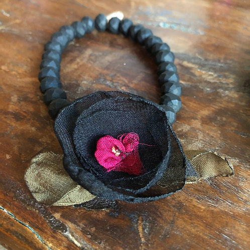 Stretchy black bead bracelet with fabric flower