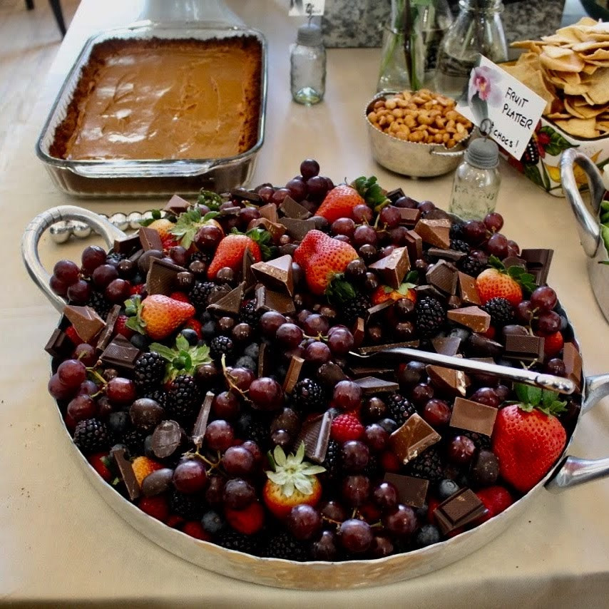 Platter with handles with berries and chocolates
