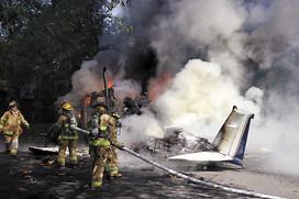 Plane crashes into neighborhood