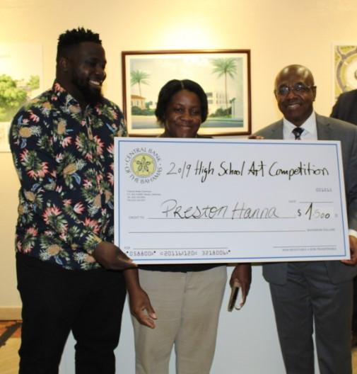 Preston Hanna receives the award on behalf of C.V. Bethel High School for best High School Participation