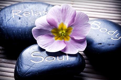 three massage stones - relax, body, soul