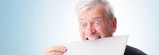 Older man angry it laptop
