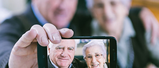 Old couple taking selfie