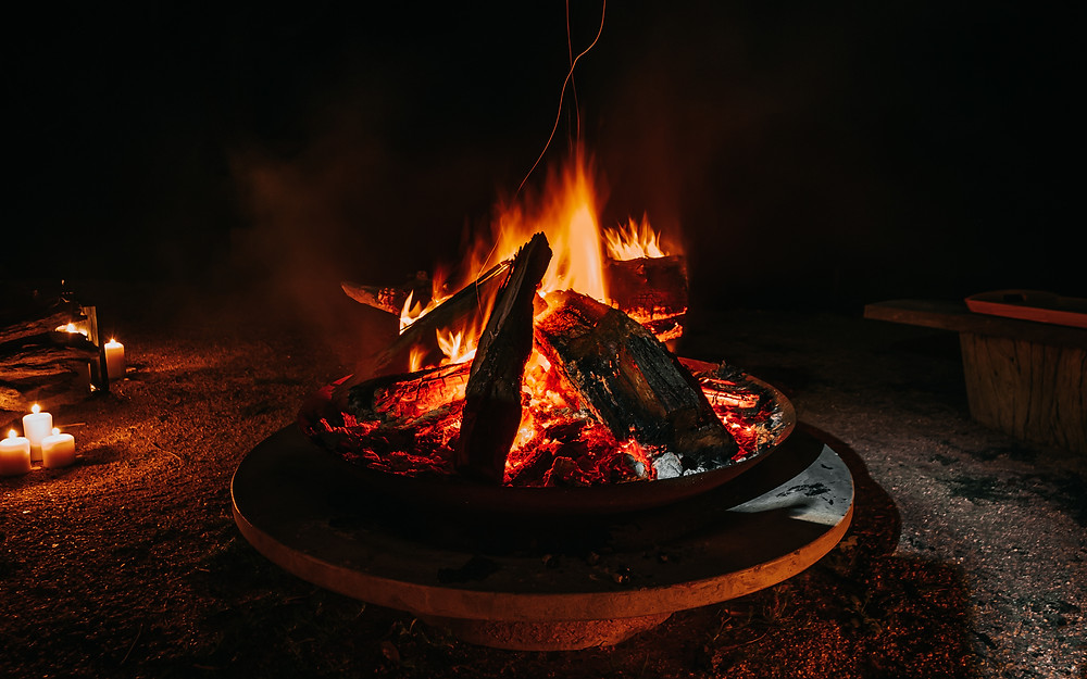 Camp fire and camping setup