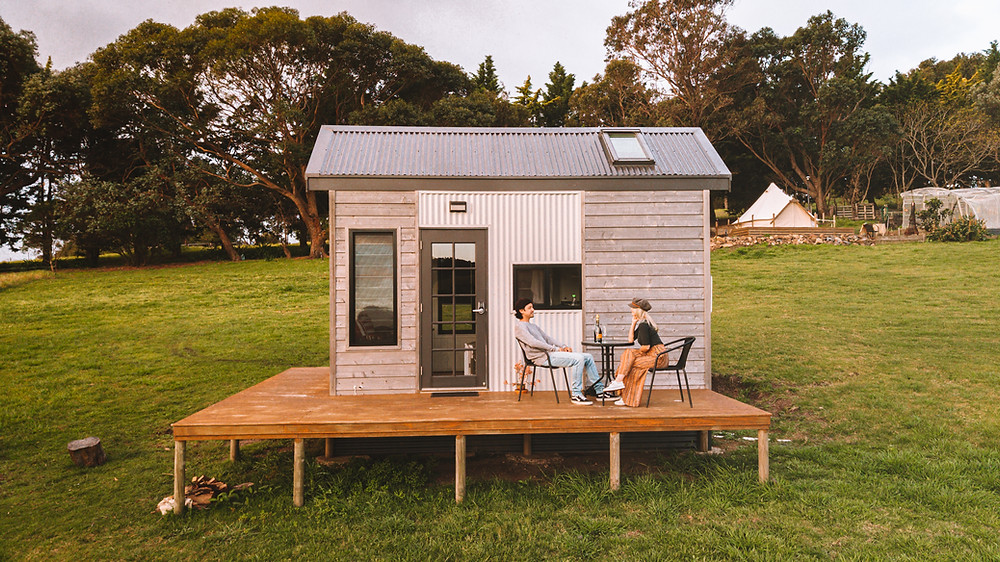 couple staying in a tiny home experiencing a unique airbnb stay in Tilba Tilba Australia