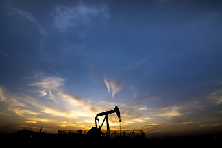 Sunset and silhouette of crude oil pump