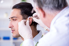Male patient with hearing problem visiti