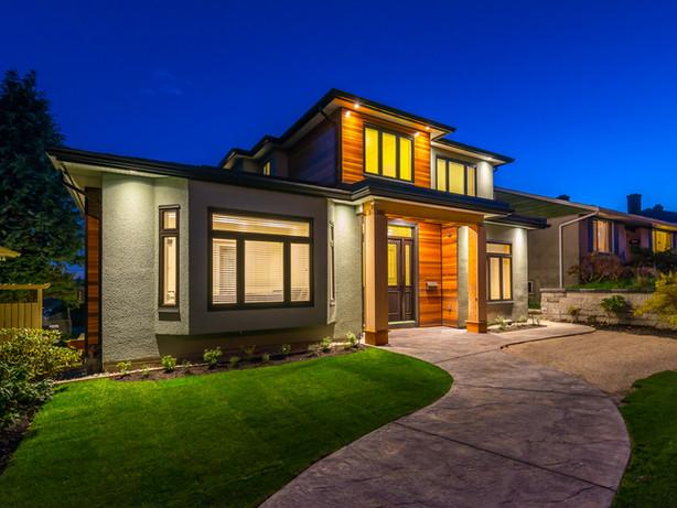 Big luxury, modern house at dusk, night