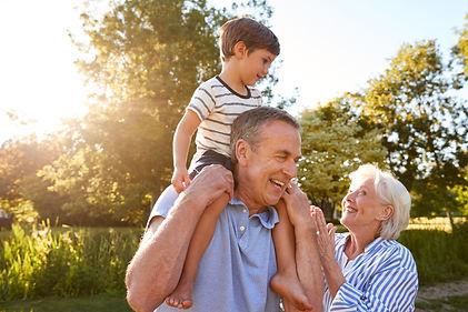 Grandparents Giving Grandson Ride On Sho