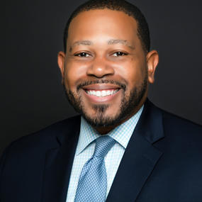 Travis J. Coy, Esq.                    President