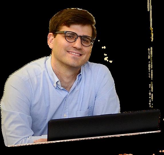 Photo of Walter Rushing behind a computer